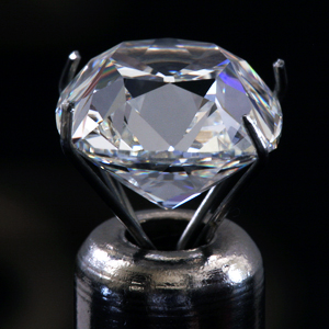 True Antique cushion diamond by Leon Mege