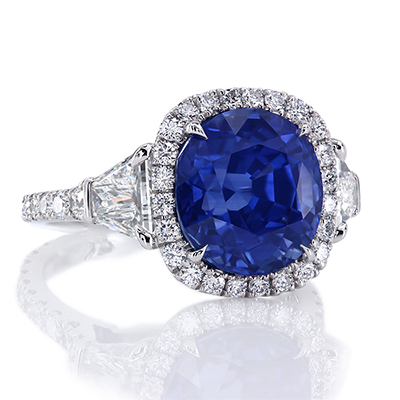 Montpassier three-stone ring, featuring 6.97 carat cushion sapphire. by Leon Mege